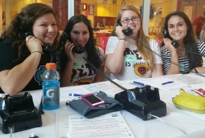 Tara Takoushian (2015),  Brittany Middleman (2016), Emily Skiba and Nicole Jakobowski (2016) answer phones from donors calling in.