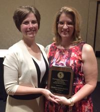 Phi Sigma Pi Executive Director Suzanne Schaffer, CAE poses with the 2015 PFA Faculty Advisor Award of Excellence Winner Charlin Jones-Chavez.